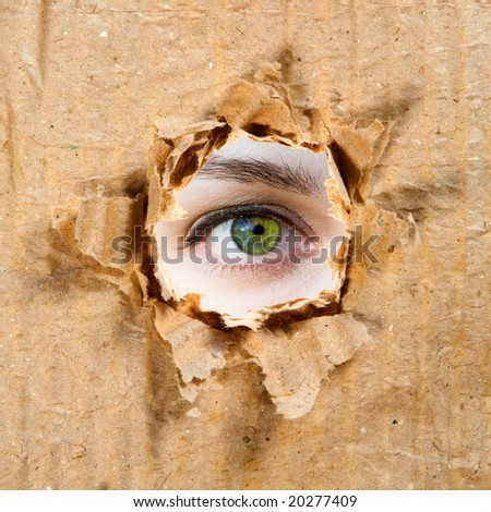 Hole in Paper And Eye. Paper and Cardboard Series.