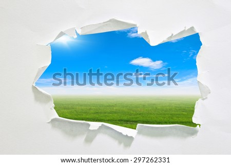 hole in paper with sky background inside