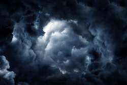 Hole in the Dark and Dramatic Storm Clouds
