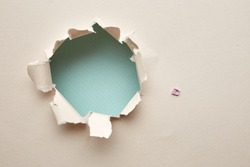 Hole in the paper. Abstract background