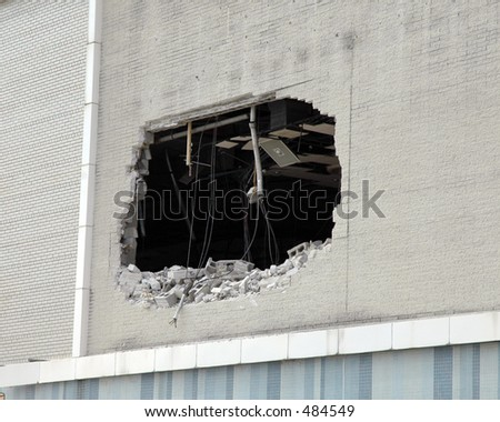Hole in the wall of a building being demolished