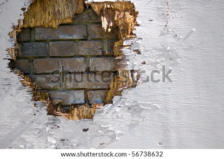 hole in wooden board , grunge brick wall background