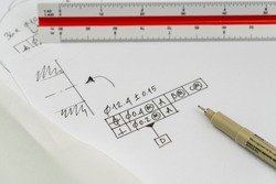 Hole positioning and dimensioning with geometrical tolerance. High resolution. Focus on pen tip. (Made up drawing)