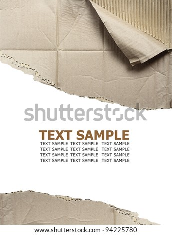 Hole ripped in corrugated cardboard on white background. with space for text or image - stock photo