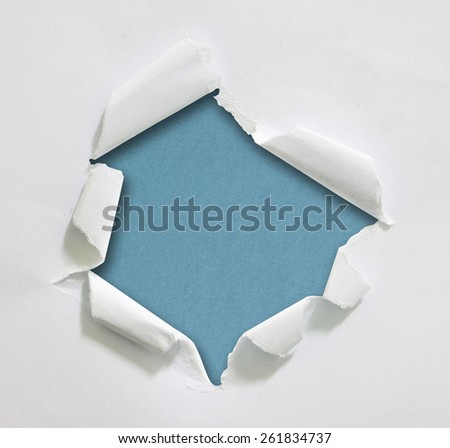 Hole ripped in paper