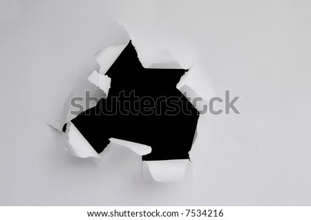 Hole ripped inward on a piece of paper