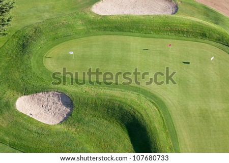 Holes and bunkers on the golf course
