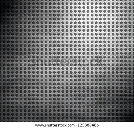 holes in a metal plate  ; abstract technology background