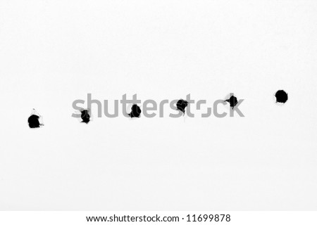 Holes on paper, isolated on white background