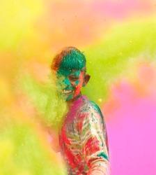 Holi celebrations - Closeup of a boy playing Holi in India.