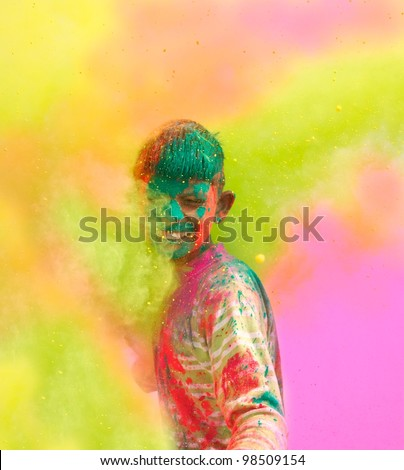 Holi celebrations - Closeup of a boy playing Holi in India.