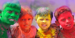 Holi celebrations - Group of kids playing Holi in India.