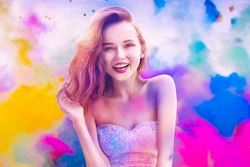 Holi Festival Of Colours. Portrait of happy young pretty girl on holi color festival. Girl with colorful long pink and blue hair smile. Colorful powder paint on dress. Energy, dancing, beautiful woman