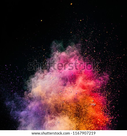 Holi powder exploding on black background. Festival of colors. Copyspace.