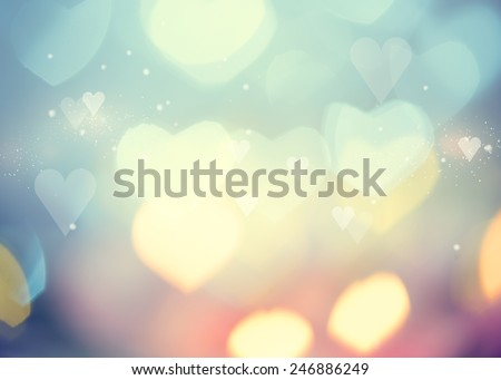 Holiday abstract glowing blurred background, bokeh. Defocused blinking heart shaped lights, vintage toned. Valentine Hearts Abstract Background. St.Valentine\'s Day Wallpaper. Heart Holiday Backdrop