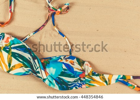 Holiday accessories on sand beach  #448354846