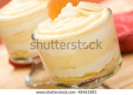 Holiday and gathering favorite banana pudding layered with whipped cream and nilla wafers