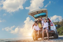Holiday and travel family concept, Summer vacations . Happy family enjoying road trip with their favorite car. Parents and children are traveling the way to the sea or ocean or river.