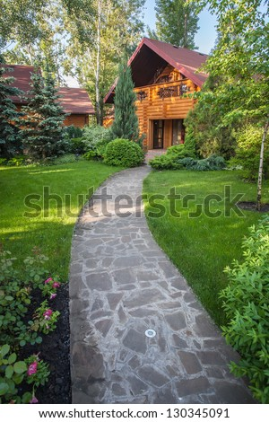 Holiday apartment - wooden cottage in summer forest