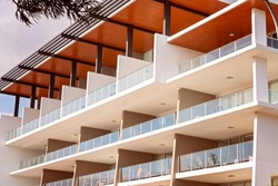Holiday apartments on multiple levels with extensive decks with glass balustrades to allow for an unhindered view of the ocean