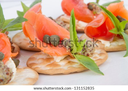 Holiday appetizer with salmon on white plate