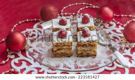 Holiday apple pie bars, garnished with fresh raspberries Near Christmas decorations.  From series Winter pastry