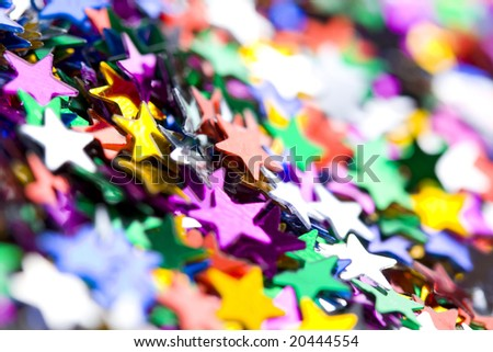Holiday background;colorful small confetti stars