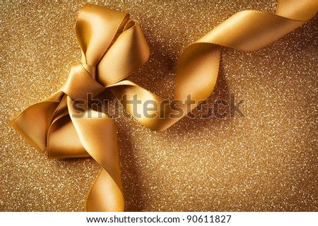 Holiday Background.Greeting Card.Gold Bow on a Blinking Background