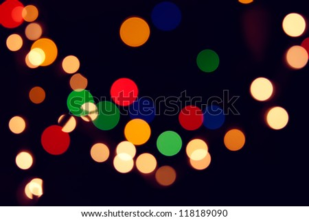 Holiday background with blurred sparkling colored lights