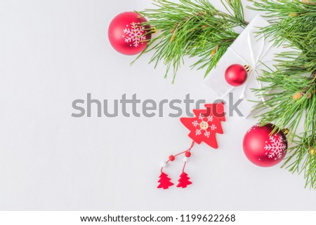 Holiday background with christmas branches and decoration on a light background #1199622268