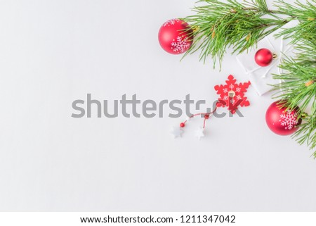 Holiday background with christmas branches and decoration on a light background #1211347042