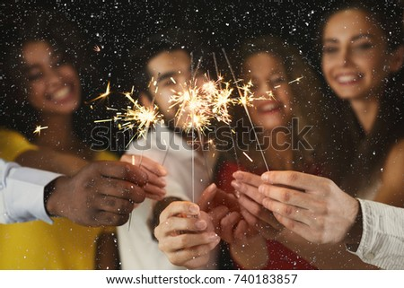 Holiday background with sparklers. Young friends holding bengal lights, closeup, selective focus. Birthday or winter holidays celebration, greeting card mockup #740183857