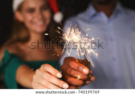 Holiday background with sparklers. Young friends holding bengal lights, closeup, selective focus. Birthday or winter holidays celebration, greeting card mockup #740199769