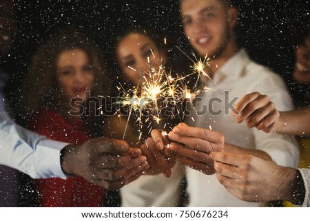 Holiday background with sparklers. Young friends holding bengal lights, closeup, selective focus. Birthday or winter holidays celebration, greeting card mockup #750676234