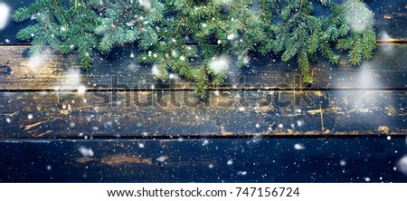 Holiday Banner Green Christmas Natural Fir Spruce on Dark Wooden Planks Vintage Background Happy New Year Greeting Card Winter Xmas Theme Copy Space for Text. Drawing Snowfall #747156724