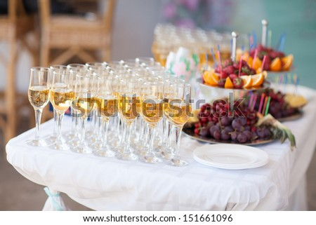 Holiday celebration. Champagne in glasses for wedding party. wedding champagne. wedding party table. wedding table. glasses of champagne