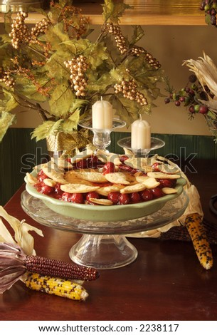Holiday Cherry Pie on a Decorative Table