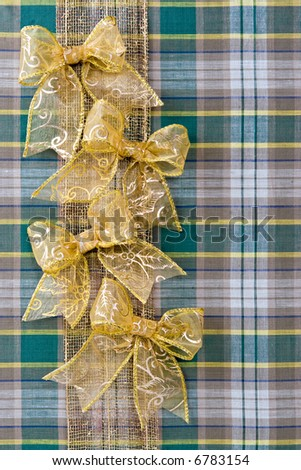 Holiday christmas packing from a fabric and gold bows