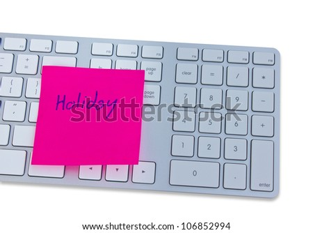 Holiday concept with computer keyboard and note with holiday.