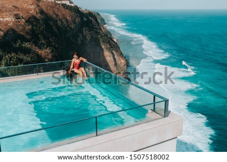 Holiday Couple relaxing in luxury with tropical water villa resort luxurious swimming pool with ocean view Bali , Indonesia #1507518002