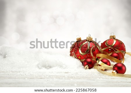 holiday decoration of red balls and golden ribbon
