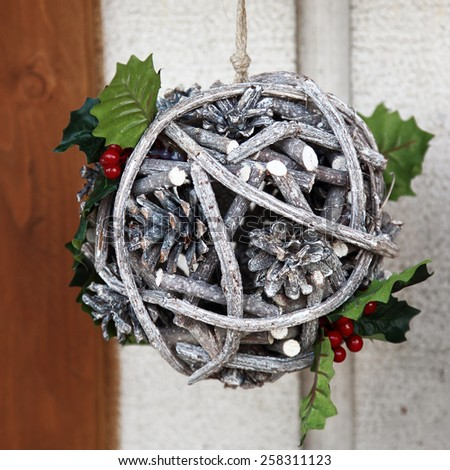 Holiday decoration of the house made of tree branches and cones