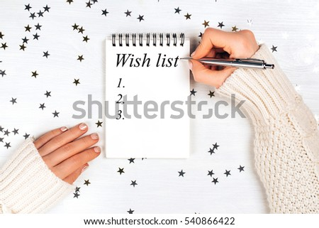 Holiday decorations and notebook with wish list on white rustic table, flat lay style. Planning concept. #540866422