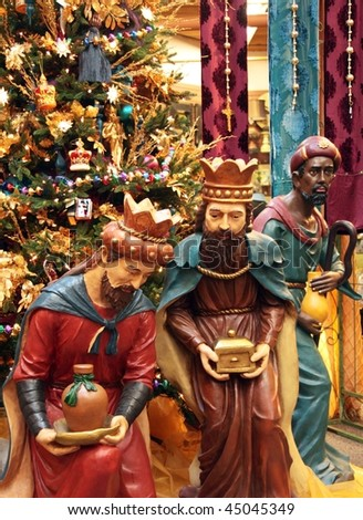 Holiday display with the three wise men and a Christmas tree