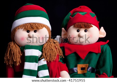 Holiday elf boy and girl with black background