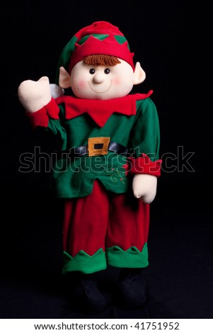 Holiday elf boy waving with black background