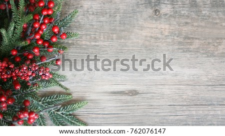 Holiday Evergreen Branches and Berries Over Rustic Wood Background #762076147