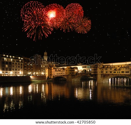 Holiday fireworks exploding over the Ponte Vecchio in Florence, Italy.