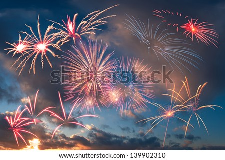 Holiday fireworks in the evening sky with majestic clouds, for design