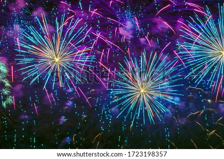 Holiday Fireworks with sparks, colored smoke and bright nebula on black sky as stars, universe, comets